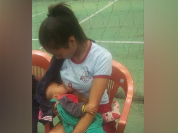 volleyball player breastfeeds child